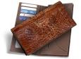Мужское портмоне из кожи крокодила Размер см: 19 х 9,5 Цвет: КОФЕ 1 прозрачное отделение 5 отделений для кредитных и...